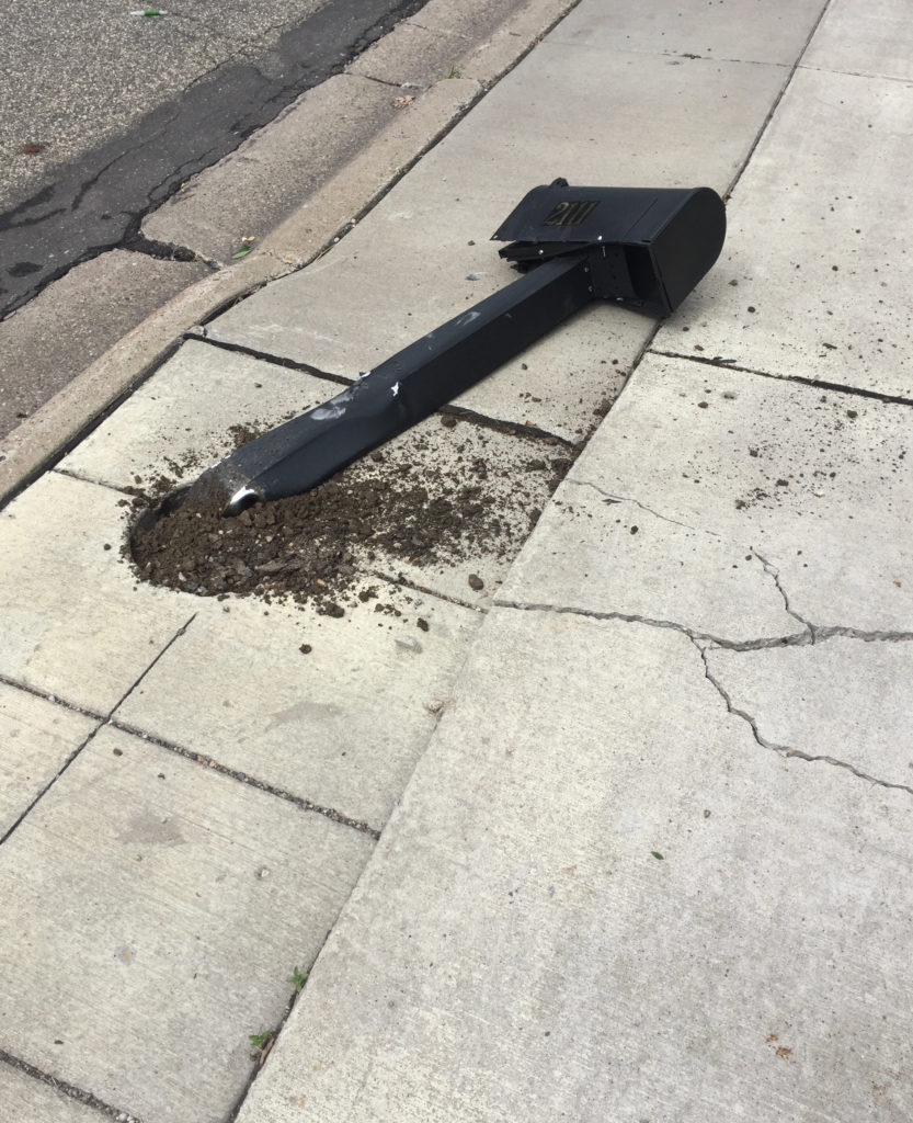 A picture of our knocked over mailbox.